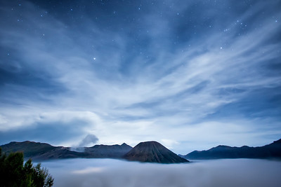 Bromo Night Sky Stars and clouds above Mount Bromo, an active volcano in Eastern Java, Indonesia