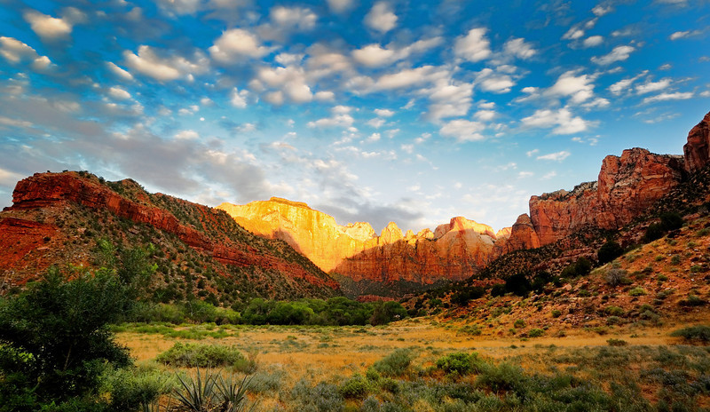 Sunrise, Zion National Park, Utah. The mountain turns an unreal shade of orange-yellow just before the sun crests.