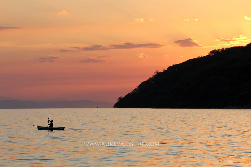 Lake Malawi<br /> <br /> A fisherman paddles his meager boat under a sublime sunset off the coast of Cape Maclear.