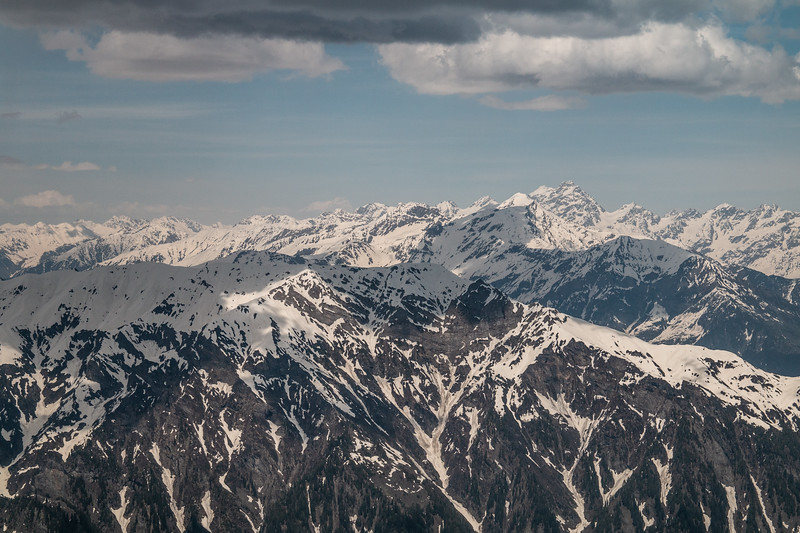 The pyramid-shaped peak towards the right is the tallest peak in the region, just over 17,000 feet.  A little to the left is a cloud on the horizon which is actually not a cloud, but the very distant Nanga Parbat, at 26,600 feet the world's 9th highest mountain. (You might be able to see it if you zoom in.)