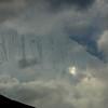 25,551-ft Rakaposhi's precipitous north face visible through the clouds from Karimabad. The name Rakaposhi means 'Shining Wall.'