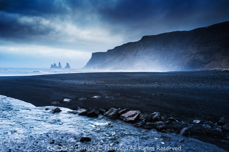 Photo 3337: Reynisdranger stacks viewed from Vik lava beach, Iceland