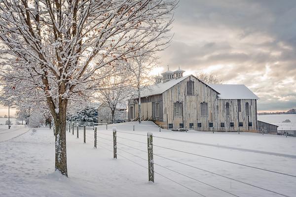 Fresh snow covered barn and farmland in Montour County, Pennsylvania