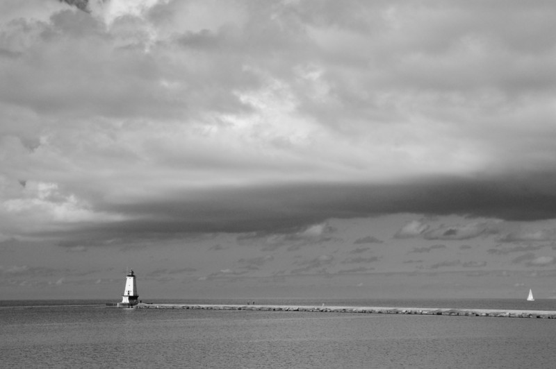 Ludington Lighthouse and Sailboat