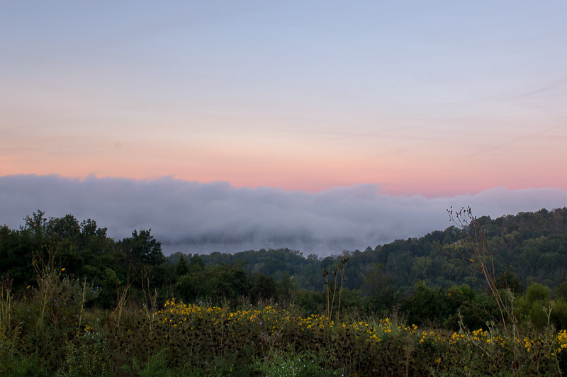 Sunrise over the Ohio River valley.  Taken from Woodland Mound Park in Cincinnati.  The fog settles on the river during these cool mornings making for some very interesting scenes.