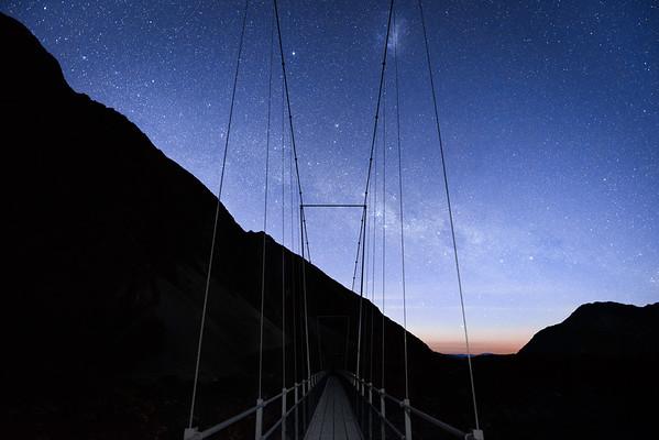 galaxy over a bridge