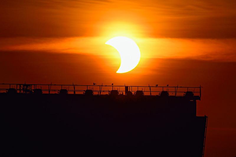 Partial solar eclipse over Marquette's Ore Dock No. 6