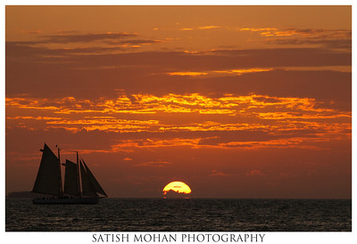 Adventure Awaits Again.....  Title suggested by my daughter from a story she's writing. This was a view from a Sunset Cruise at Keywest, Florida. Switched to my 200mm lens to capture the yatch sailing towards the setting sun just in time.