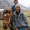 A boy leading his younger brother on horseback above the village of Kyanjin Gompa. / Langtang Himal, Nepal