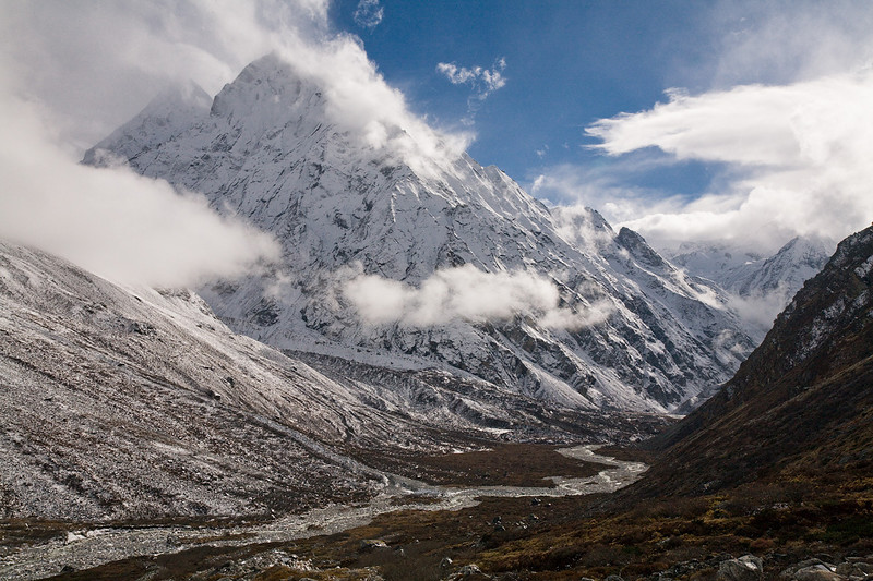 Clouds drape across the summit of Langshisa Ri in the Upper langtang Valley. / Langtang Himal, Nepal