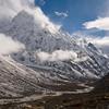 Clouds drape across the summit of Langshisa Ri in the Upper langtang Valley. / Langtang Himal, Nepal
