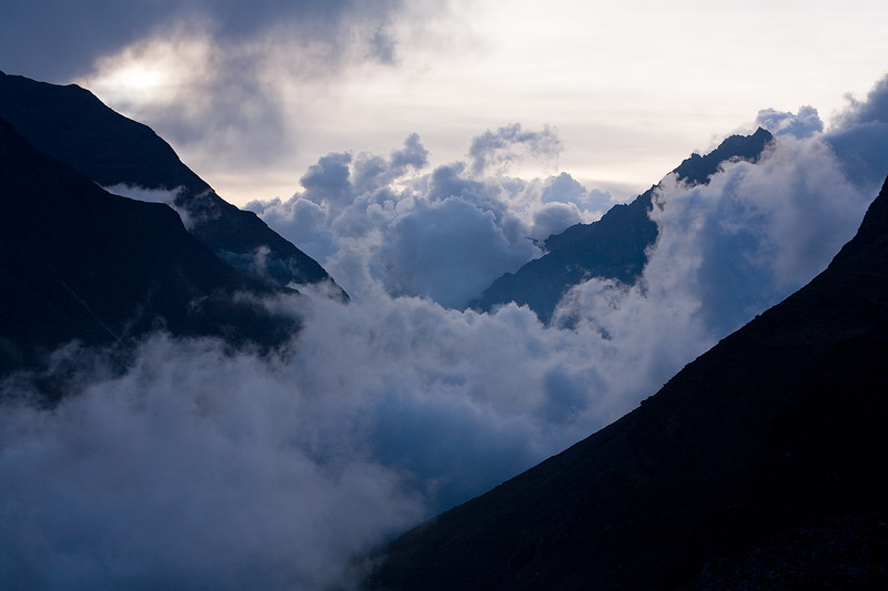 A view of the clouded Lower Langtang Valley. / Langtang Himal, Nepal