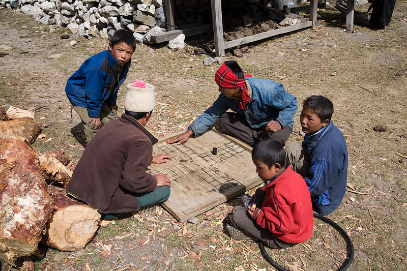Nepalis playing the ancient Indian game of pachisi in the village of Kyanjin Gompa. / Langtang Himal, Nepal
