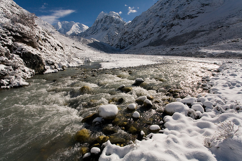 The Langtang Khola flowing through the frozen wilderness of the Upper Langtang Valley. / Langtang Himal, Nepal