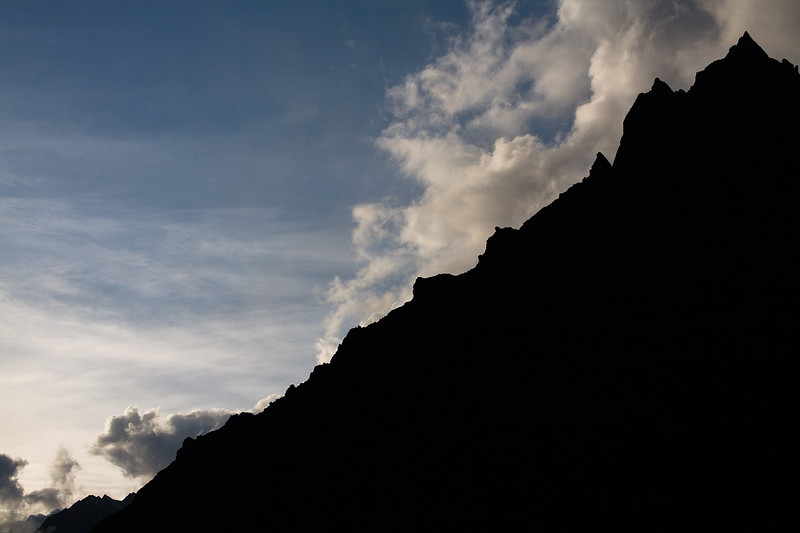 The sharp rocky summit of Pangshungtramo silhoutted against afternoon clouds. / Langtang Himal, Nepal