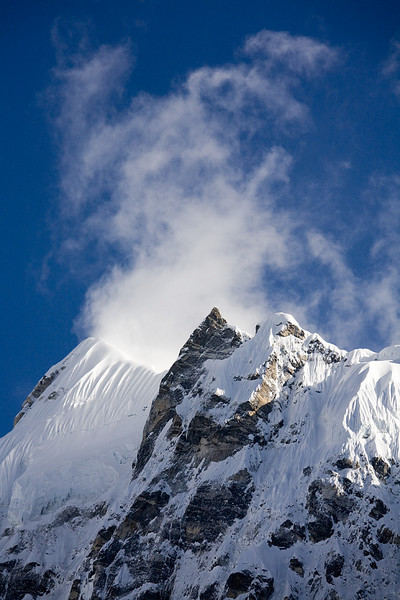 Clouds rise over the granite walls of the Upper langtang Valley. / Langtang Himal, Nepal