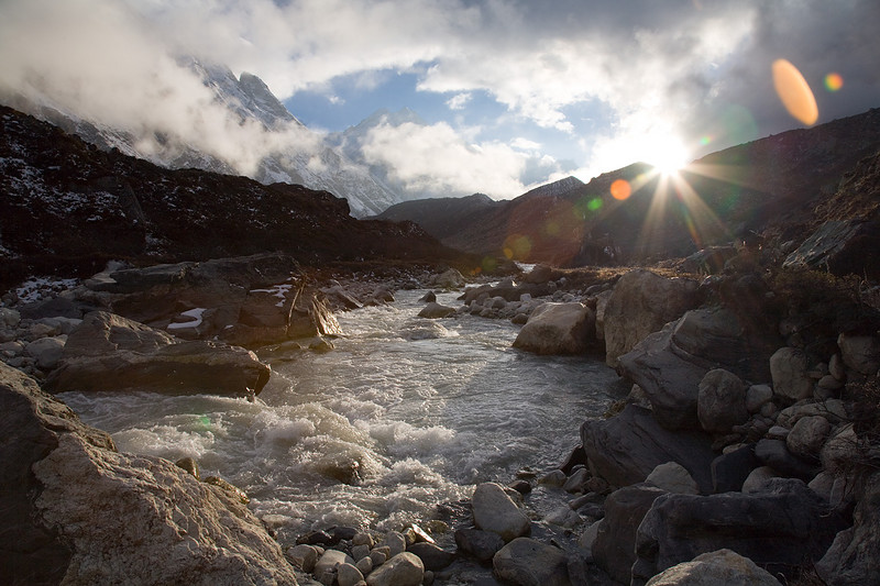 The sun sets over the waters of the Langtang Khola near the summer grazing area of Langshisa Kharka. / Langtang Himal, Nepal