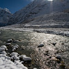 Sunlight shimmers on the icy waters of the Langtang Khola in the Upper Langtang valley. / Langtang Himal, Nepal