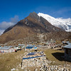 The village of Kyanjin Gompa lies just below the 7246 meter summit of Langtang Lirung. / Langtang Himal, Nepal