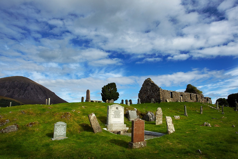 Cill Chriosd Graveyard with the Red Cuillins behind.