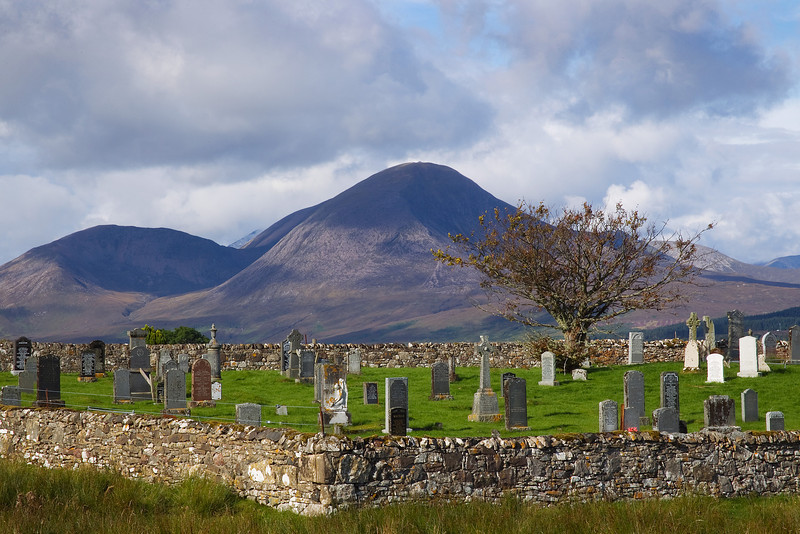 Lower Breakish Graveyard Skye with the Red Cuillins in the background.
