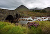 Old Bridge at Sligachan with Glamaig Mountain in the background. Every year there is a race from the Hotel to the top of Glamaig and back-the record stands at just under 50 minutes!
