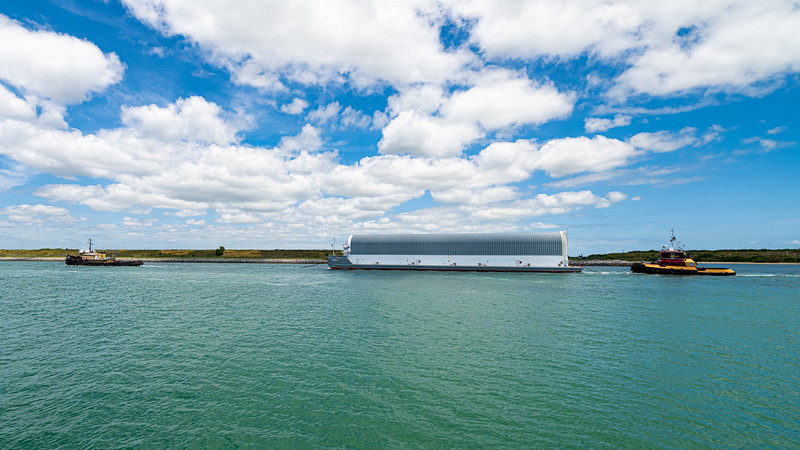 April 27, 2021: NASA's Pegasus barge carrying the Space Launch System core stage for the Artemis I mission passes through Port Canaveral on its way to Kennedy Space Center.