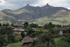 Sotho dwellings - near the village of Ha Potiane - adjacent to the twin conical foothill peaks of Thabanali-Mele (partially cloud shaded in this image) of the Thaba Putsoa Mountains - Lesotho.