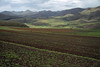 """Corn fields along the foothills of the Thaba Putsoa Mountains - Lesotho.  Sorghum, beans, peas, and wheat are the other main agricultural crops raised in this country, which is nicknamed """"Kingdom in the Sky""""."""