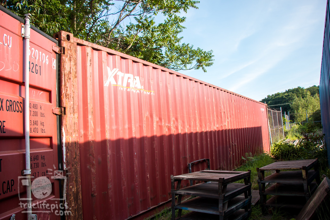 Pre Mural Canal red shipping container side