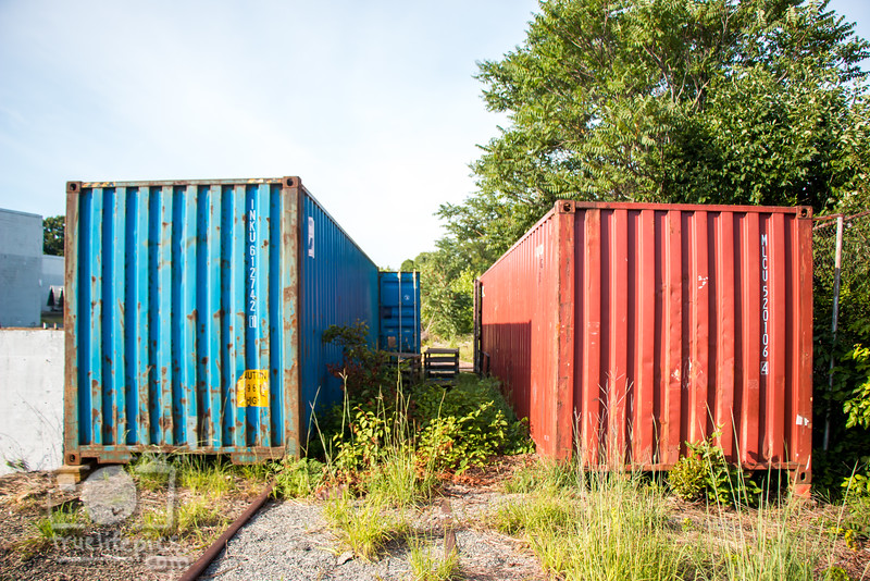 Pre Mural Canal back of red and blue shipping containers
