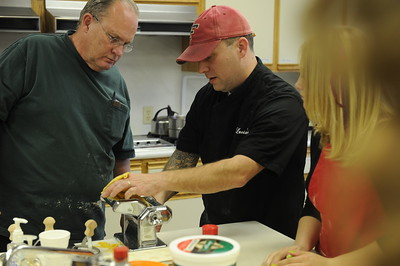 Luc Gerber, center, demonstrates how to use a pasta maker while he hosts a cooking workshop called the Whole Ravioli. Trained in Europe, Gerber has worked in many places including some top restaurants in San Francisco, he owns a local restaurant in Elko called Lucianos.   Scenes from the 28th annual National Cowboy Poetry Gathering in Elko Nevada. February 1, 2012.
