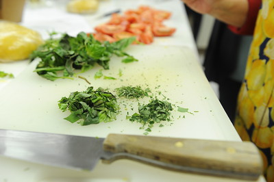 Detail of basil and other herbs to be used in both the fillings and the sauces.  Luc Gerber hosts a cooking workshop called the Whole Ravioli. Trained in Europe, Gerber has worked in many places including some top restaurants in San Francisco, he owns a local restaurant in Elko called Lucianos.   Scenes from the 28th annual National Cowboy Poetry Gathering in Elko Nevada. February 1, 2012.