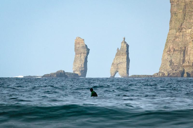 Surfing close to Risin & Kellingin sea stacks.