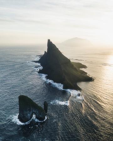 Sunset behind Drangarnir,Tindholmur and Mykines Island.