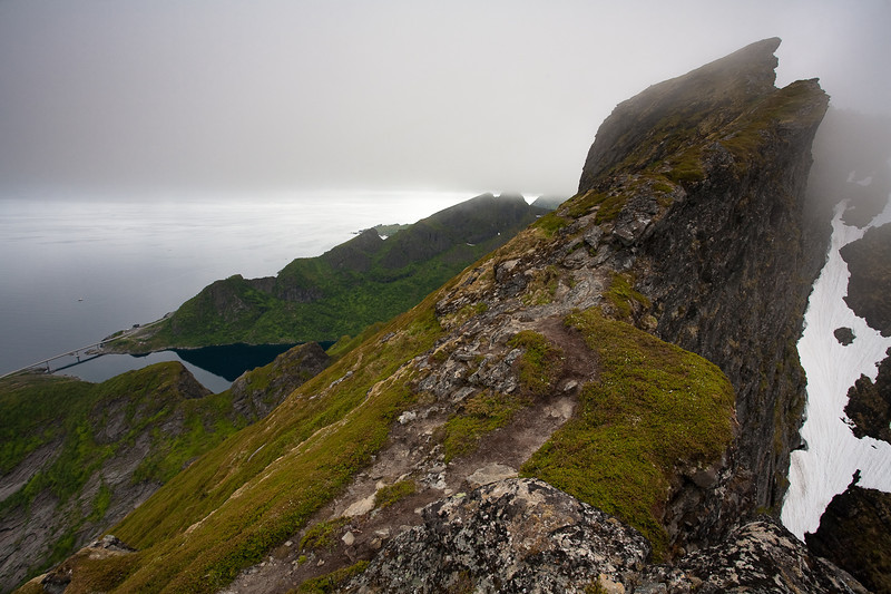 View from summit ridge of Mt. Reinebringen. A bridge on King Olaf's Way, the main road that links the Lofoten Islands to the mainland, can be seen in the lower left.
