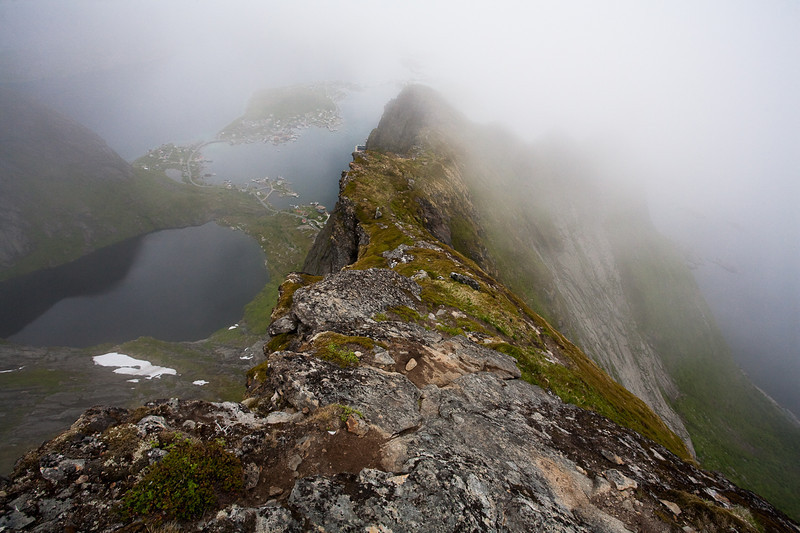 View from the clouded summit ridge of Mt. Reinebringen, Lofoten.