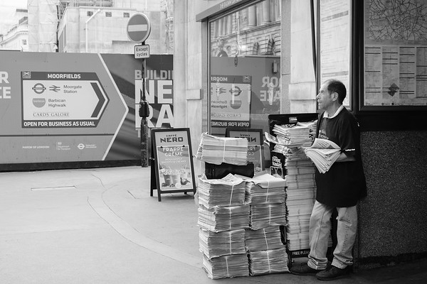 This man handed out the Evening Standard, a free daily newspaper, outside the Moorgate subway station every day.