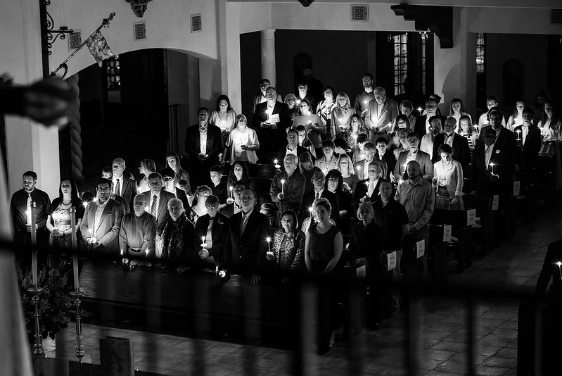 The assembled listen to the Exsultet during Easter Vigil.