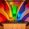 The pipe organ in Helzberg Hall, illuminated in rainbow light.