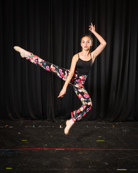 I took one hundred individual photos before the spring dance recital of KC Young Audiences, and she was the only dancer who asked if they could try being airborne. It made her memorable in a sea of faces.