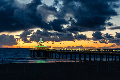 Holiday Lights on the pier, after a big November storm. Manhattan Beach, California.