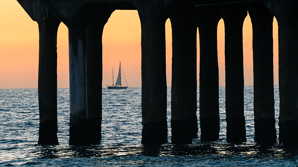 Sail away.  Sunset at Manhattan Beach pier.