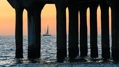 Sail away.  Sunset at Manhattan Beach pier.