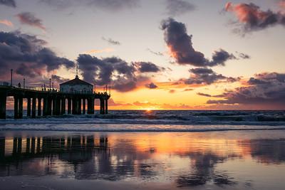 Manhattan Beach pier at sunset, after a big November storm.