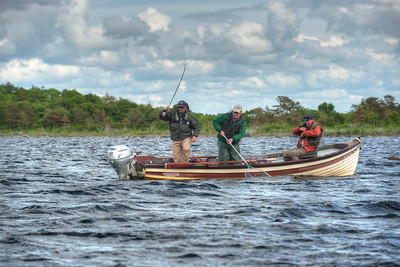 Playing a good brown trout on Lough Mask, Mayo