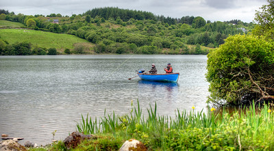 Trout anglers flyfishing from a boat at Callow Lough, Mayo
