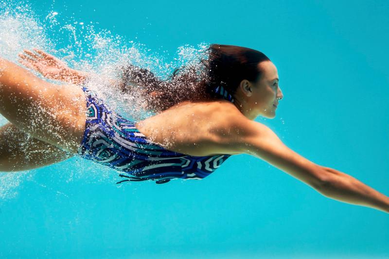 Beautiful brunette swimming underwater