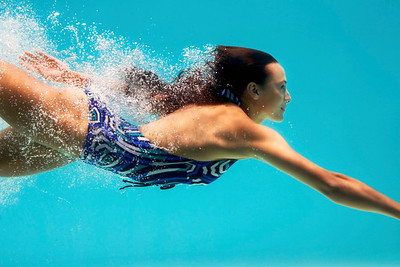 Beautiful brunette swimming underwater