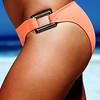 Body shot of girl on the beach in an orange swimsuit